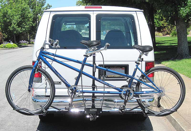 Tandem bike transported on hitch rack