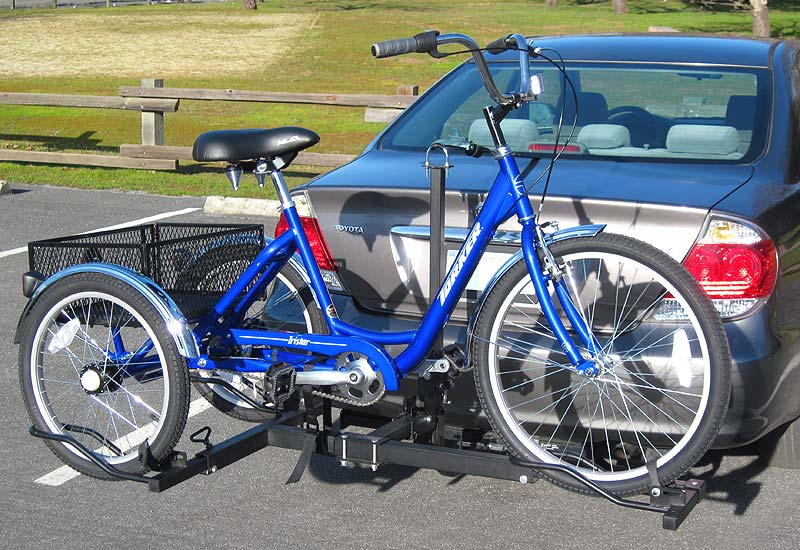Adult trike on hitch mounted rack