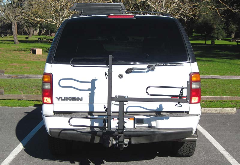 Trike rack in folded up position on SUV